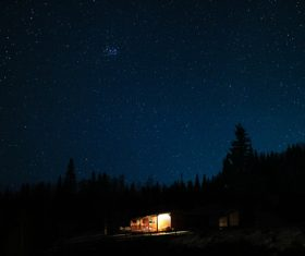 Small cottage under starry sky Stock Photo