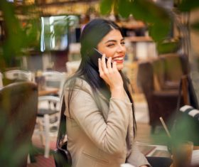 Smiling woman answering the phone Stock Photo