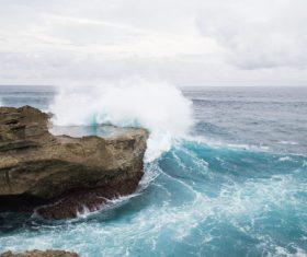 Splashing waves on rocky beach Stock Photo