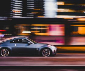Sport car driving fast on street Stock Photo