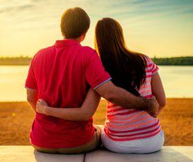 Sweet couple enjoying the sunset Stock Photo 04