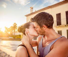 Sweet couple enjoying the sunset Stock Photo 05