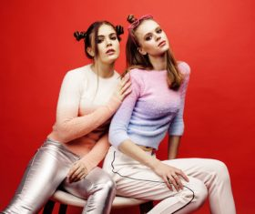 Two fashion hairstyle girls taking pictures in the studio Stock Photo 03