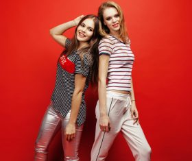 Two girls posing with red background Stock Photo 05