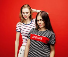 Two girls posing with red background Stock Photo 06