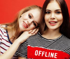 Two girls posing with red background Stock Photo 09