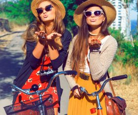 Two girls riding bicycle outing Stock Photo
