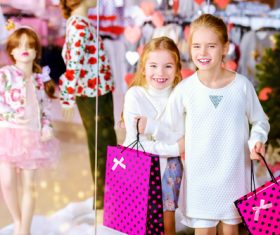 Two little girls shopping in the mall Stock Photo