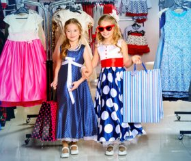 Two stylishly dressed little girls in the mall Stock Photo
