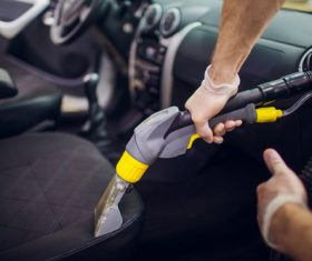 Use vacuum cleaner to clean the interior of the car Stock Photo