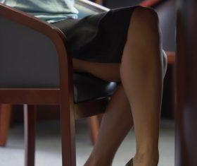 Using laptop woman legs close up Stock Photo