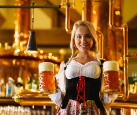 Waitress holding two glasses of beer Stock Photo 02