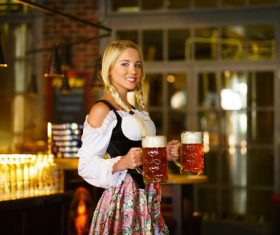 Waitress holding two glasses of beer Stock Photo 05