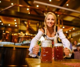 Waitress holding two glasses of beer Stock Photo 06