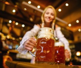 Waitress holding two glasses of beer Stock Photo 07