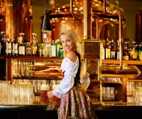 Waitress holding two glasses of beer Stock Photo 09