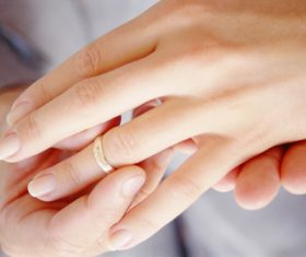 Wearing wedding ring Stock Photo