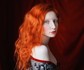 White skin redhead girl Stock Photo