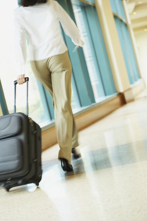 Woman dragging a suitcase to travel Stock Photo