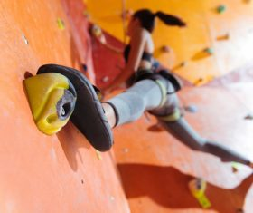 Woman indoor rock climbing Stock Photo 02