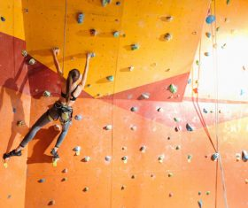 Woman indoor rock climbing Stock Photo 03
