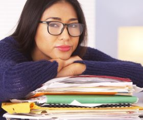 Woman lying listlessly on the folder Stock Photo