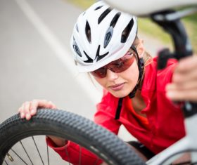 Woman resting on bicycle Stock Photo