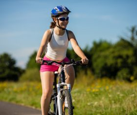 Woman riding bicycle exercise Stock Photo