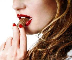 Woman tasting chocolate Stock Photo 01