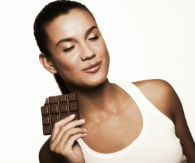 Woman tasting chocolate Stock Photo 05