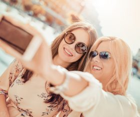 Woman using cell phone selfie Stock Photo