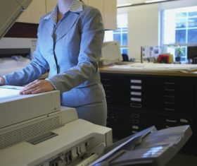 Woman using copier Stock Photo