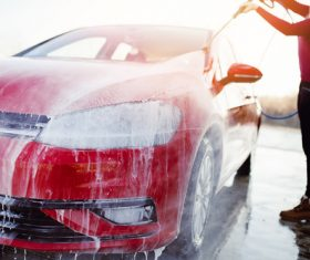 Woman washing car Stock Photo
