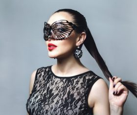 Woman wearing black butterfly mask Stock Photo 01