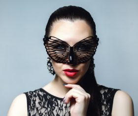 Woman wearing black butterfly mask Stock Photo 03