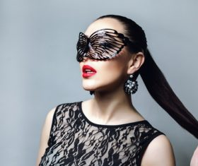 Woman wearing black butterfly mask Stock Photo 04