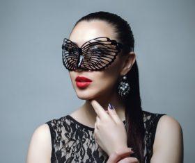 Woman wearing black butterfly mask Stock Photo 05