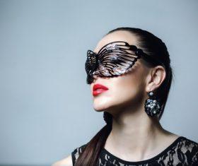 Woman wearing black butterfly mask Stock Photo 06