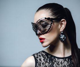 Woman wearing black butterfly mask Stock Photo 07