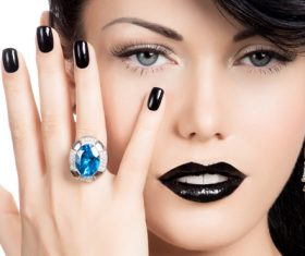Woman with fashion make up and hairstyle wears blue gemstone ring Stock Photo 06