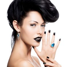 Woman with fashion make up and hairstyle wears blue gemstone ring Stock Photo 07