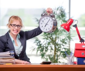 Woman working overtime Stock Photo