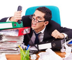 Work overload hysterical man Stock Photo