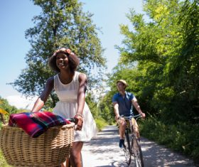 Young friends traveling on bicycle Stock Photo
