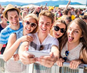 Young friends who use smartphones selfie Stock Photo