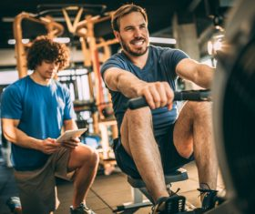 Young man doing exercise in gym Stock Photo