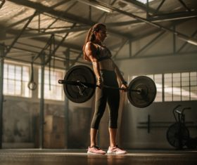 Young woman lifting weights for fitness Stock Photo