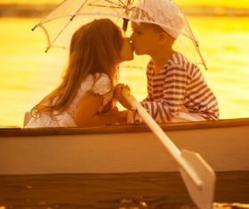 little boy boating on the lake with little girl Stock Photo 01