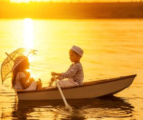 little boy boating on the lake with little girl Stock Photo 02