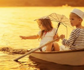 little boy boating on the lake with little girl Stock Photo 03